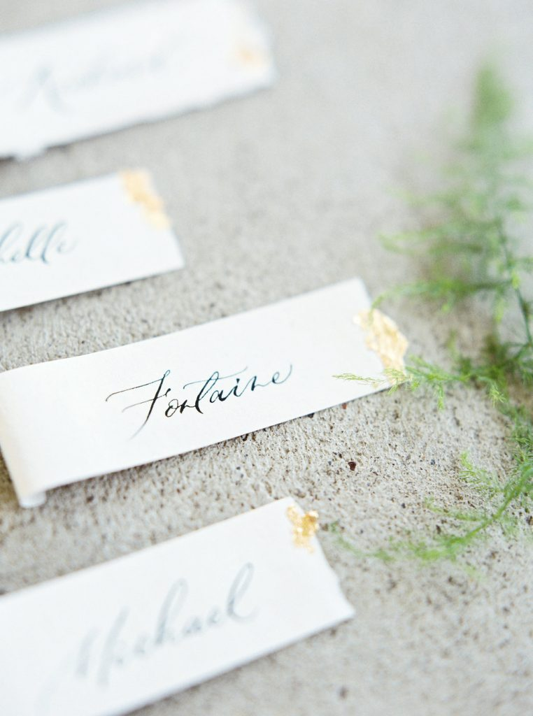 Scroll-style place cards on handmade paper