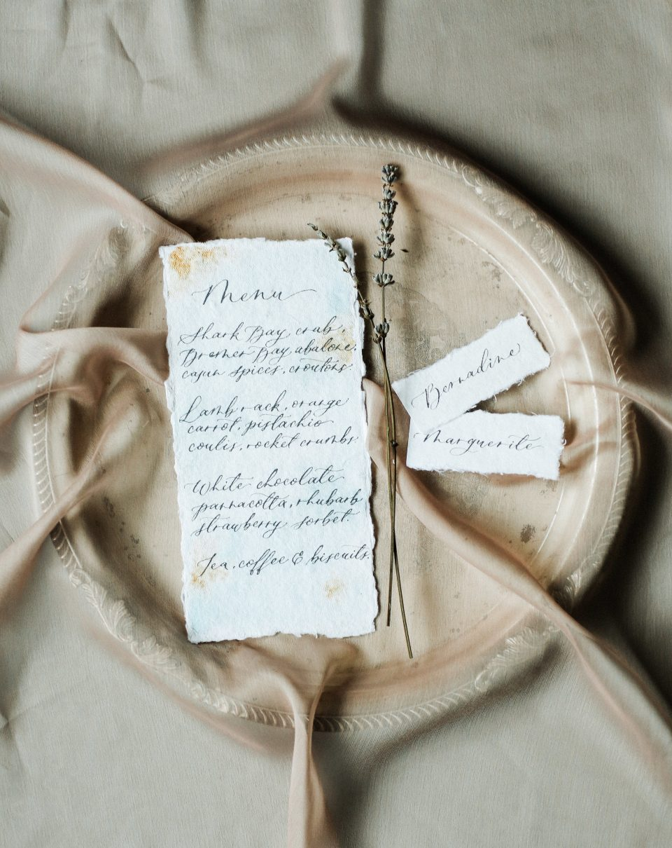 Vintage inspired wedding menu and place cards on handmade paper