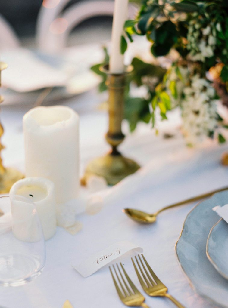 Guest scroll-style place card on elegant table setting